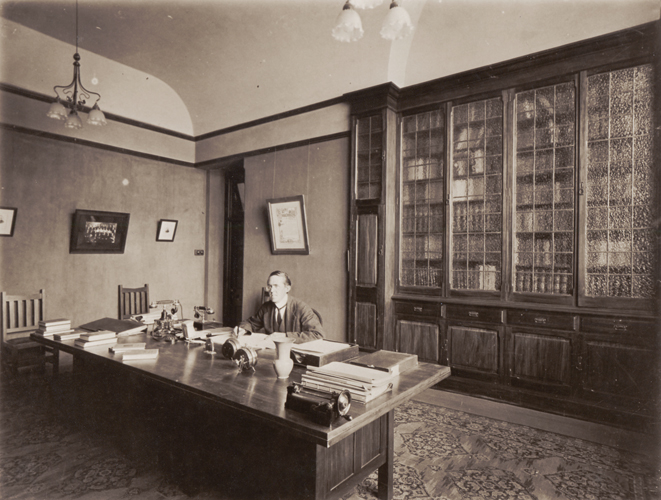 1902 — George George, Auckland Technical School's first Director, in his Rutland Street office.