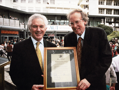 1999 — Tertiary Education Minister Max Bradford (left) and AIT President Dr John Hinchcliff at the announcementthat the institution would become a university from 1 January 2000.