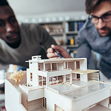 Two architects working on model home