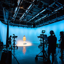 Students in TV studio recording room