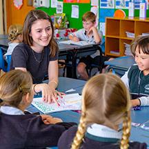 Teacher in classroom with kids