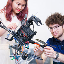 Students with robotic drone